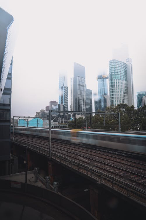 Gray Concrete Bridge Near City Buildings