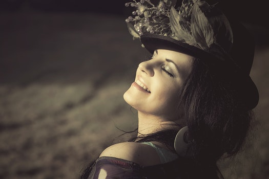 Woman in Black Hat Smiling