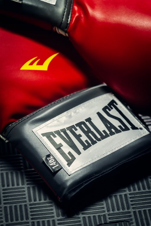 Boxing gloves with colorful emblem