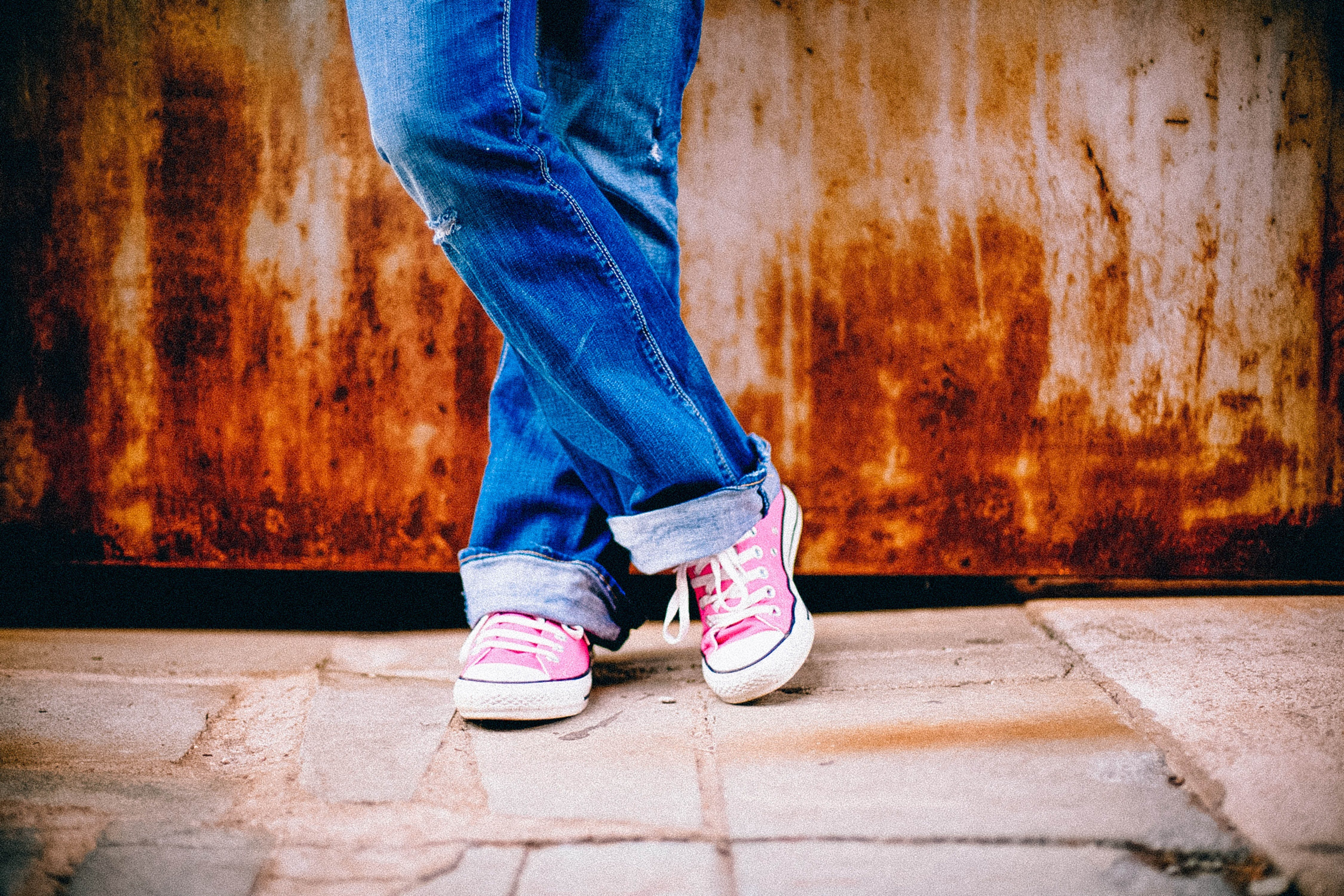 Person in Blue Jeans and Pink White Converse All Star Sneakers