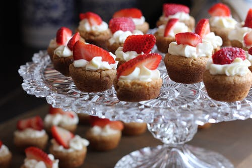 Cupcake With Strawberry Toppings on Clear Glass Cup Cake Rack