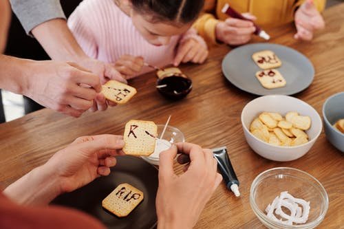 Family Writing RIP On Biscuits