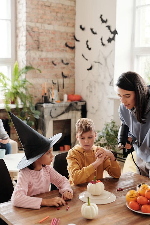 A Family Preparing Decorations For Halloween