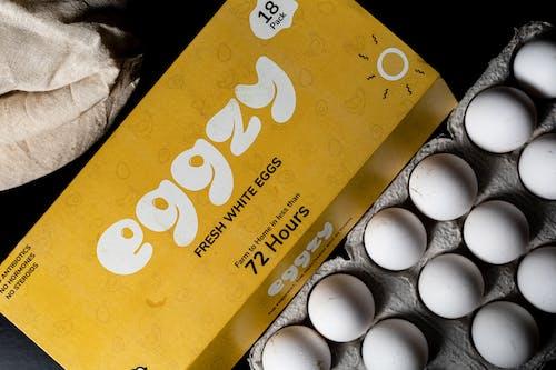 White Egg on Brown Box