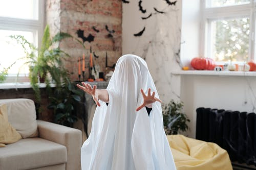 Kid In A Ghost Costume