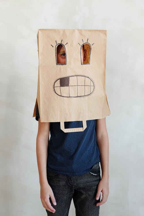 Person With A Brown Paper Bag On His Head