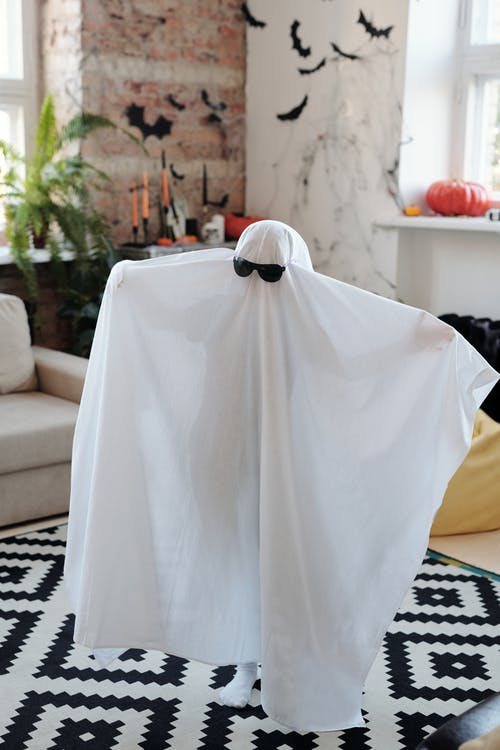 Kid Wearing A Ghost Costume