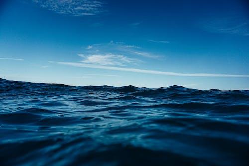 Waving sea under blue sky