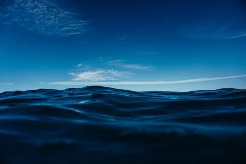 Rippling blue sea surface against cloudless sky