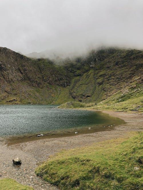 Green Mountain Beside Body of Water