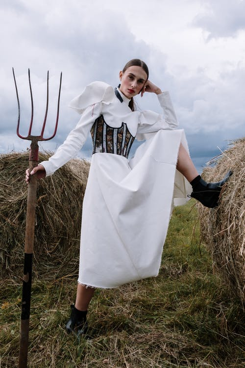 Woman Holding a Fitchfork