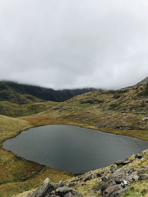 Lake in the Middle of Green Mountains