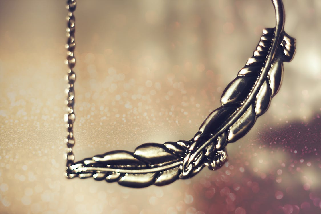 Silver feather jewelry