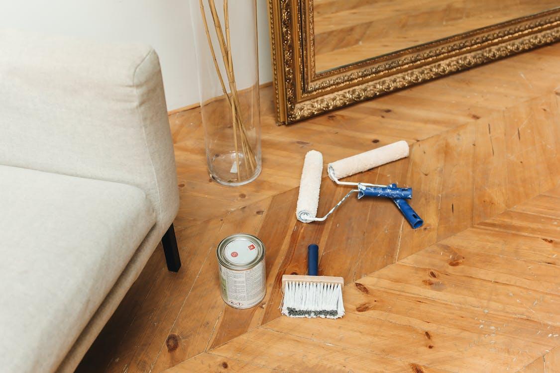 Blue and White Hair Brush Beside Clear Glass Bottle
