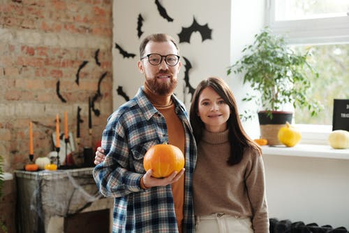 Man Holding A Pumpkin