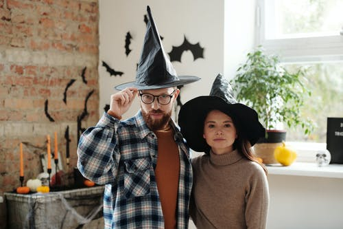 Portrait Of A Couple Wearing Witch Hats