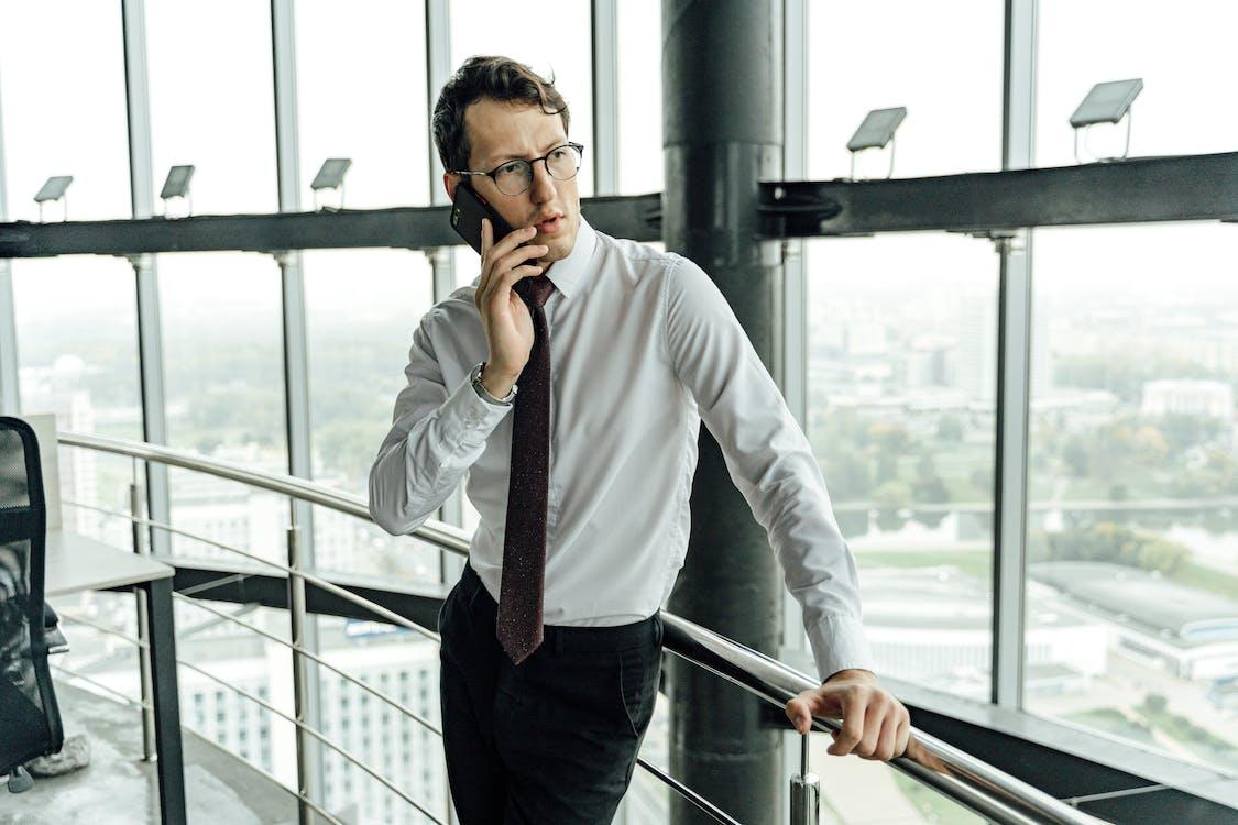 https://www.pexels.com/photo/man-in-white-dress-shirt-and-black-pants-wearing-black-framed-eyeglasses-5583992/