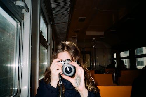 Girl in Blue Jacket Holding Camera