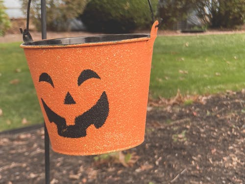 Close-Up Photo of a Jack-o'-Lantern Bucket