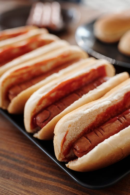 Hotdog Sandwiches on A Black Tray