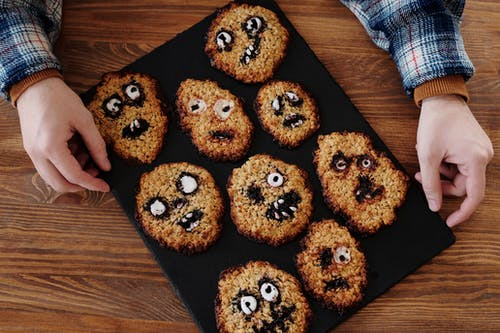 Brown Cookies Decorated With Various Facial Expressions