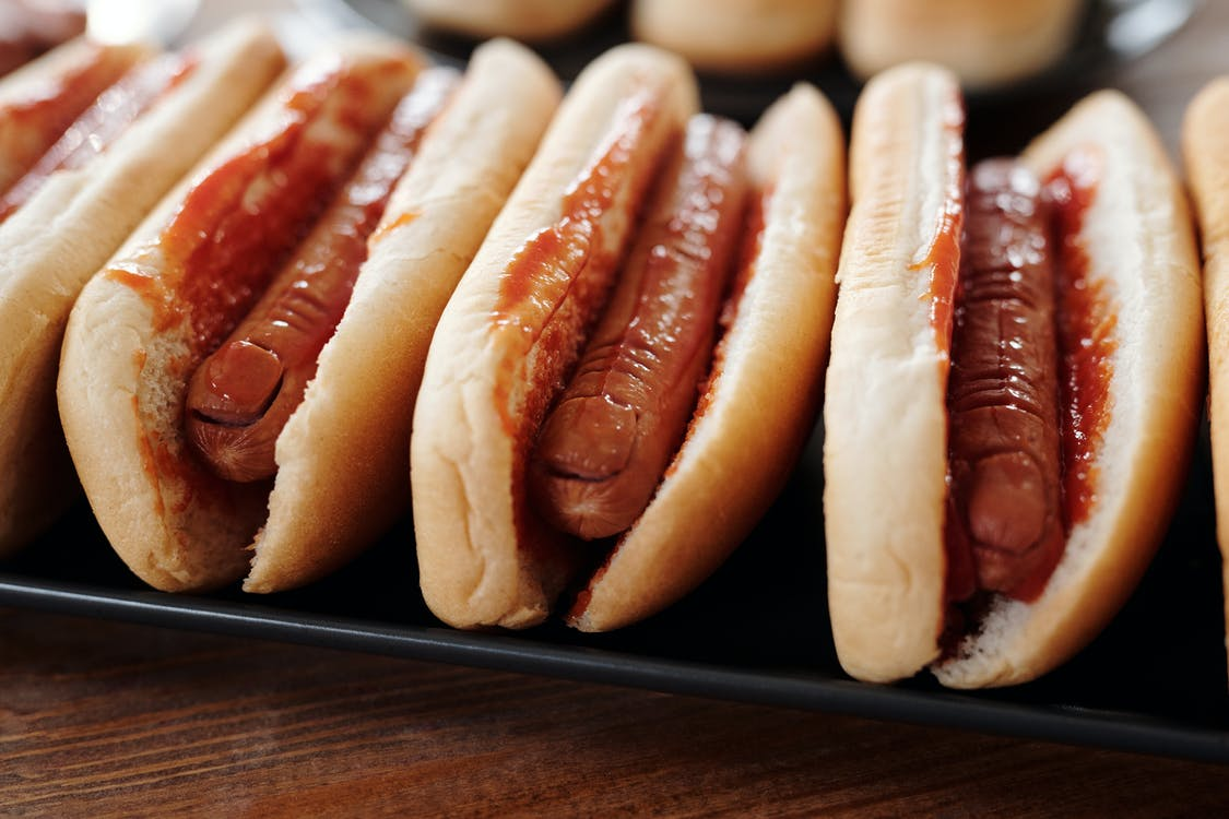 Hotdog Sandwiches on Black Tray