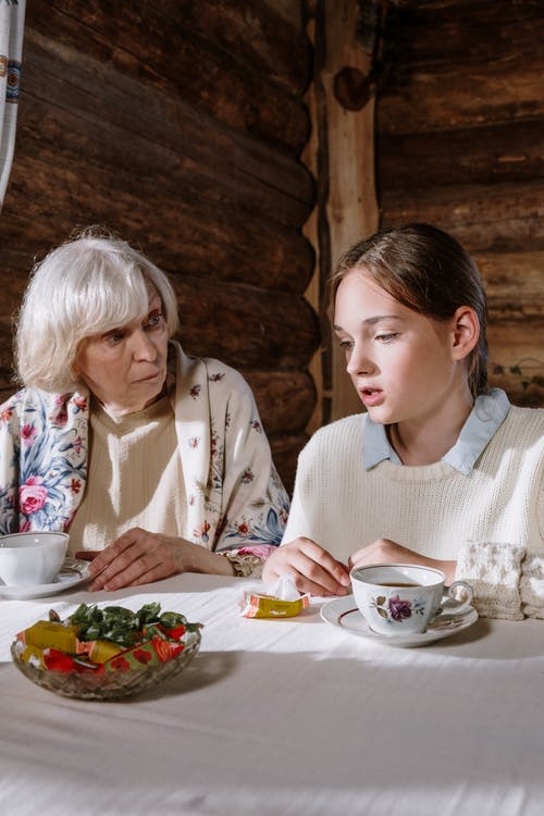 2 Women Eating on Table