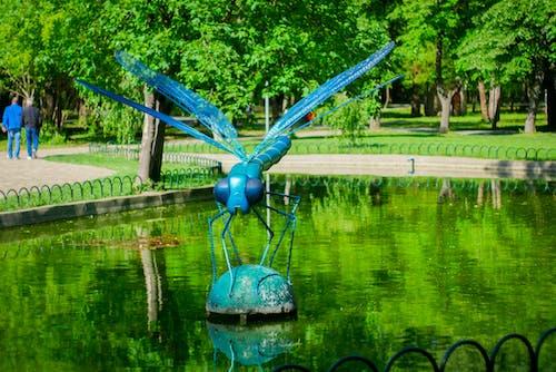 Photos gratuites de libellule, parc, statue