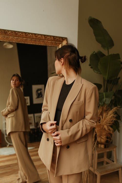 Woman Fitting a Brown Coat