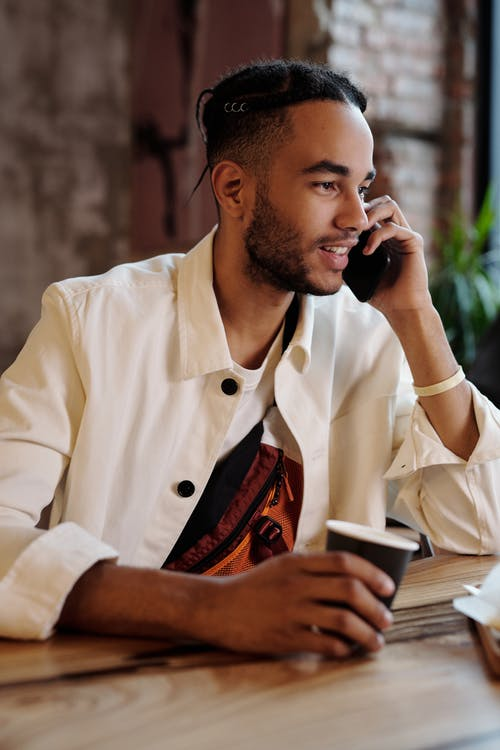 Man in White Button Up Shirt Holding White Smartphone