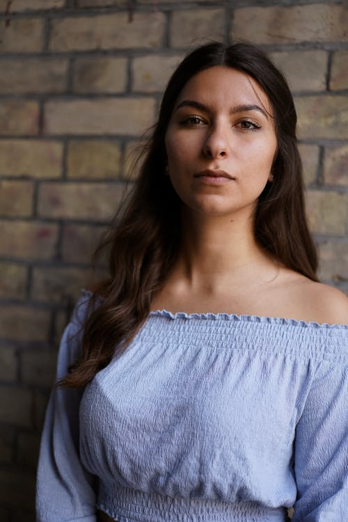 Woman in Blue Off Shoulder Shirt with Long Hair