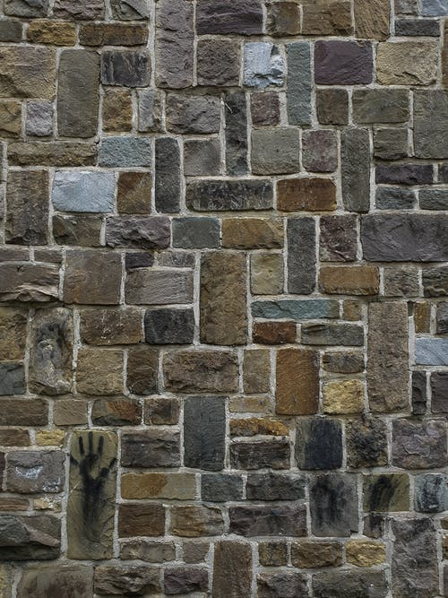 Brown and Gray Brick Wall