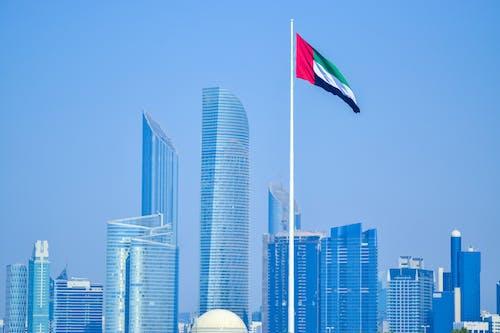 Flag of Us a on Pole Near High Rise Buildings