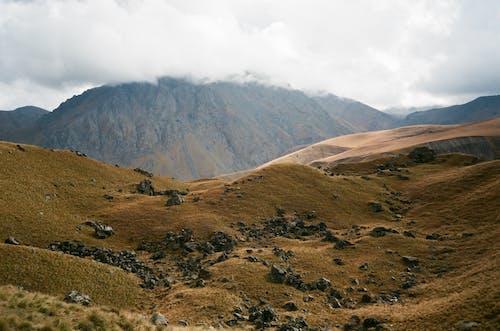 Spectacular mountain ridge against foggy sky