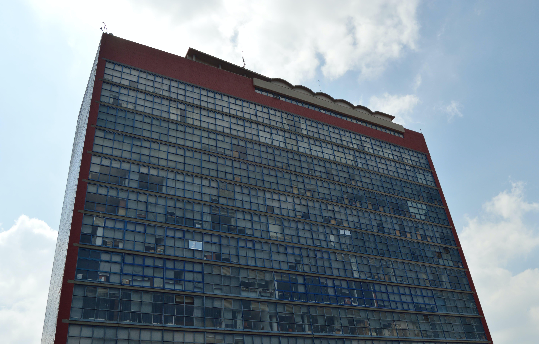 Blue Concrete High-rise Building Under Blue Cloudy Sky