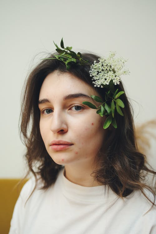 A Woman with Flowers on Her Hair