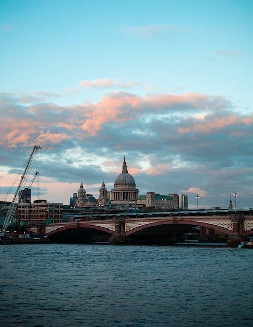 Photo of Brown Bridge over Body of Water During Daybreak