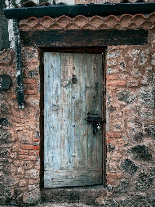 Old wooden door in stone building