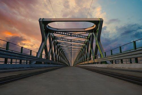Gray Concrete Bridge Under Gray Sky