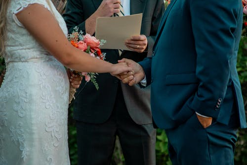 Groom and Bride Holding Hands