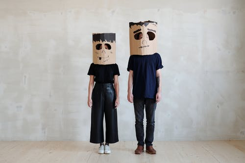 Two Persons Wearing a Diy Cardboard Box Mask