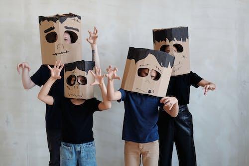 A Family Wearing a Diy Cardboard Box Mask