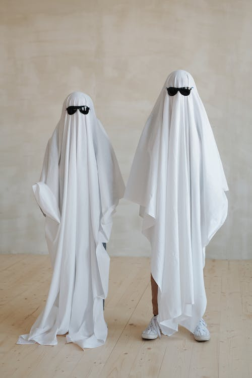 Two Persons Wearing a White Halloween Costume