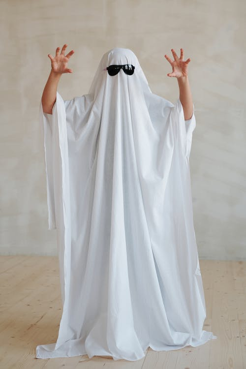 Person Wearing White Halloween Costume and Sunglasses