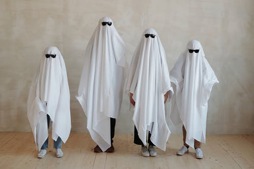 A Family Wearing White Halloween Costume