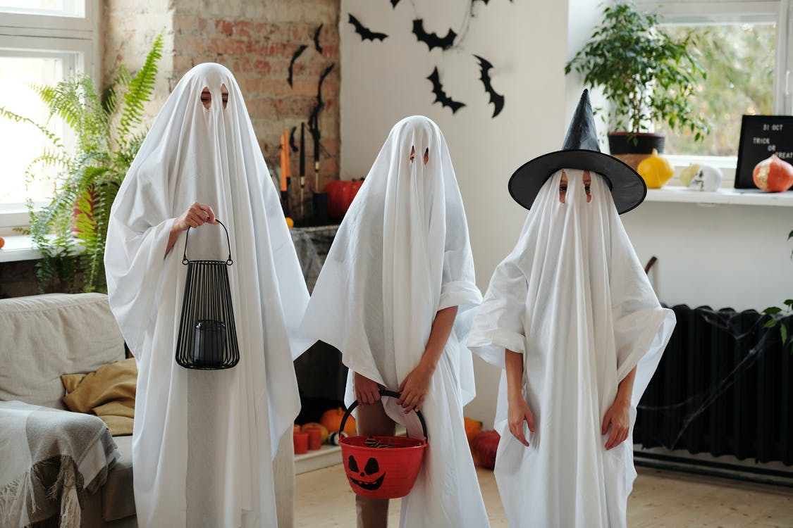 People in Ghost Costumes