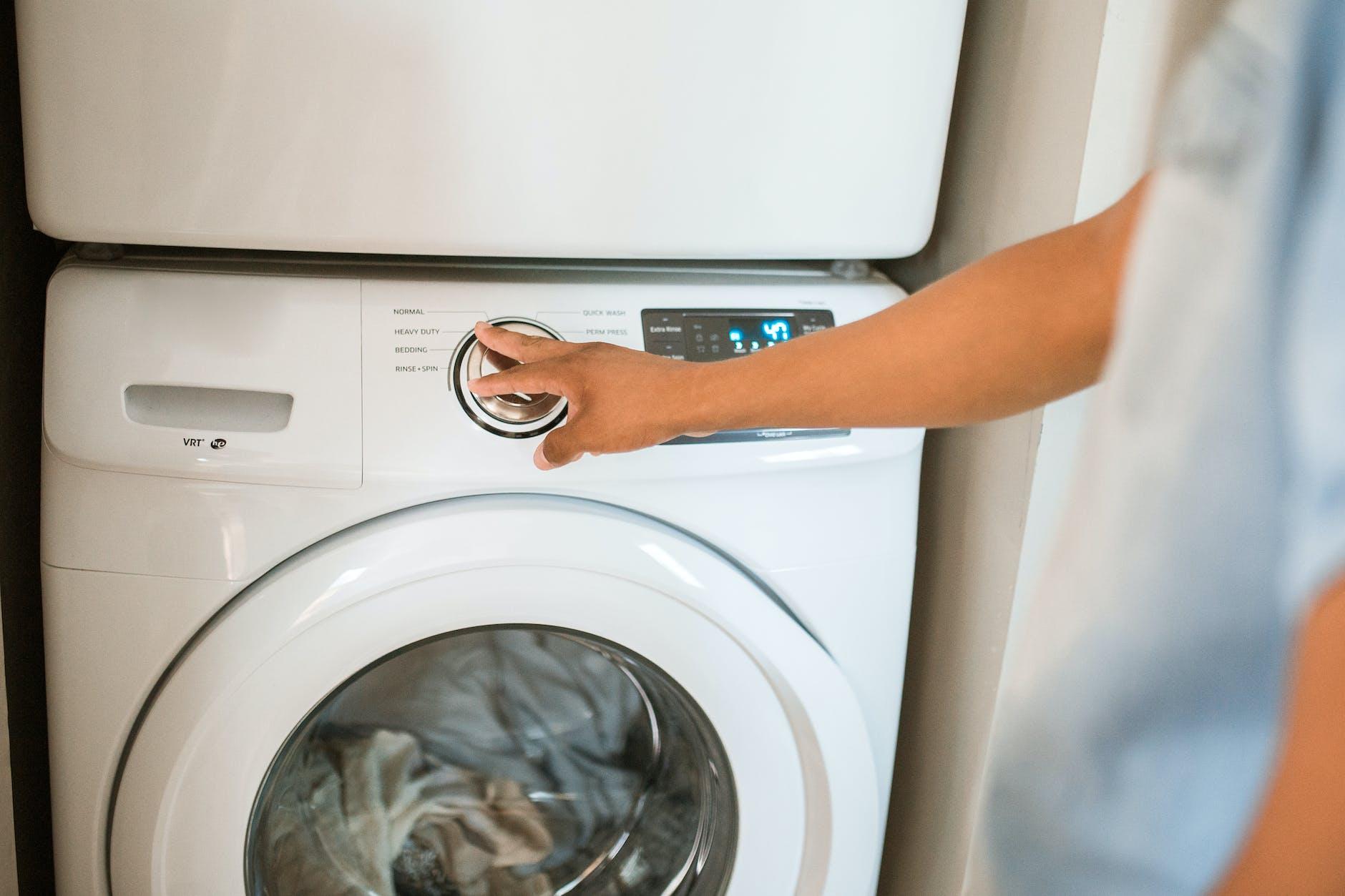 To clean around the washing machine.