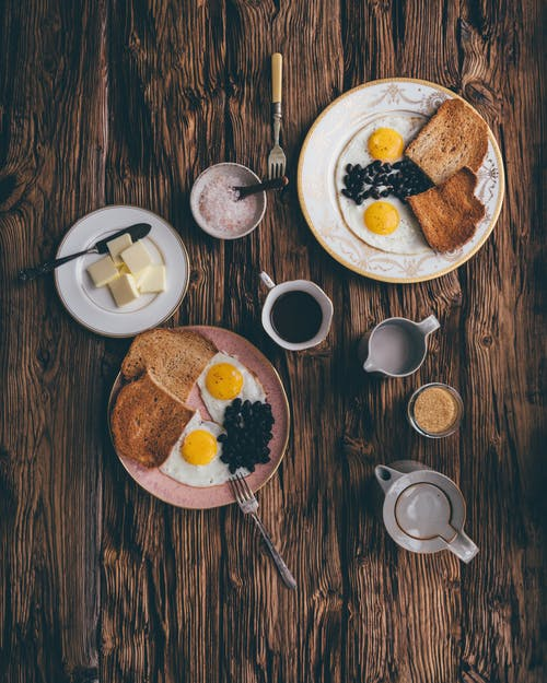 Served delicious breakfast on wooden table