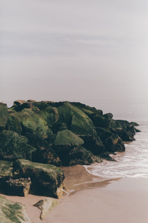 Rocky formation near calm sea water