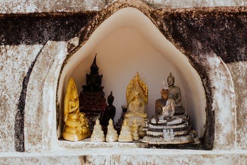 Gold Buddha Figurine on White Ceramic Heart Shape Tray